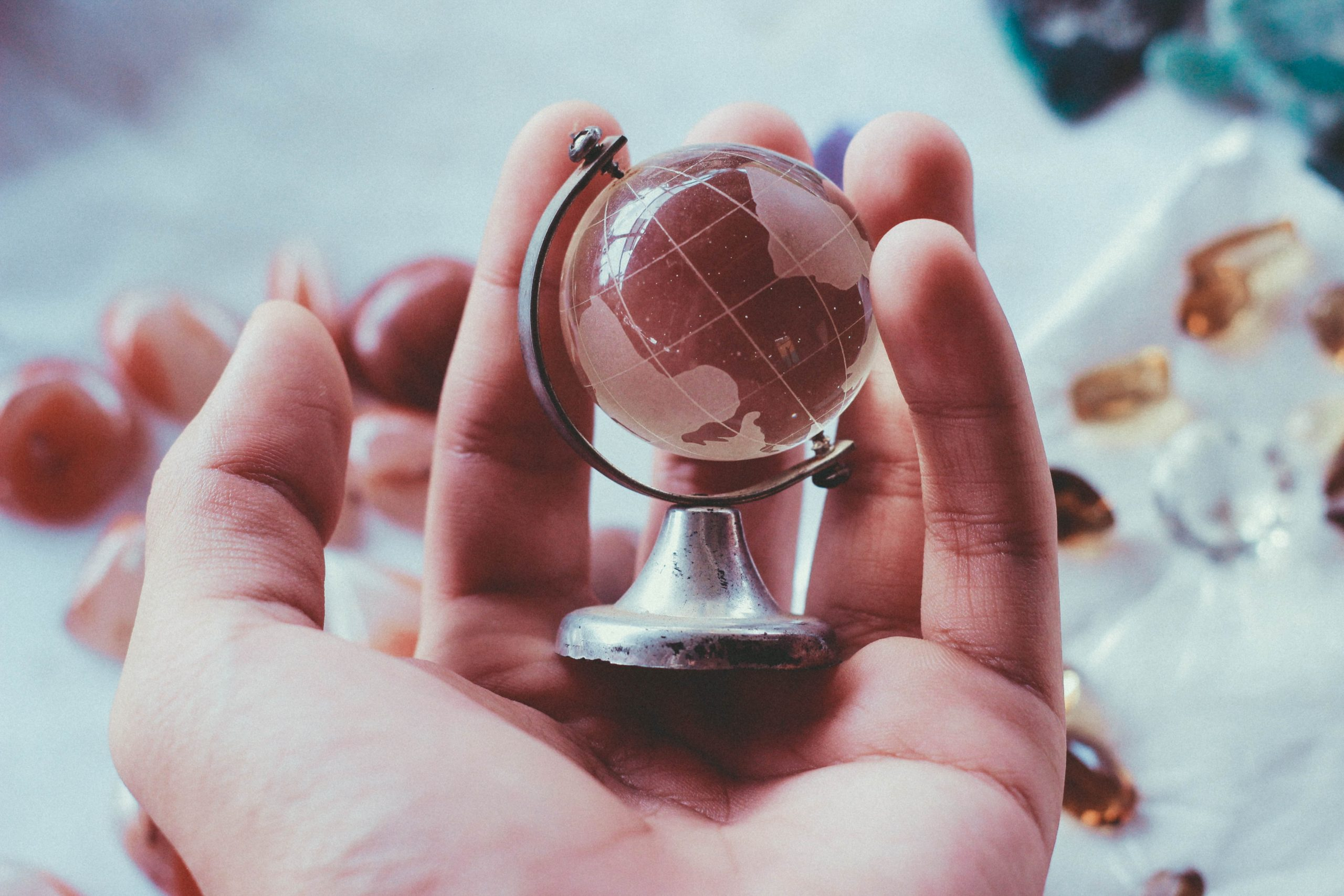 glass globe on a hand